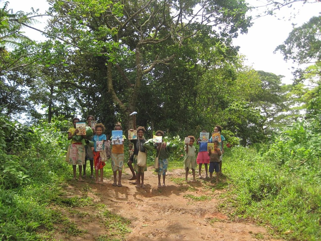 Kids carrying books from West to East Maewo