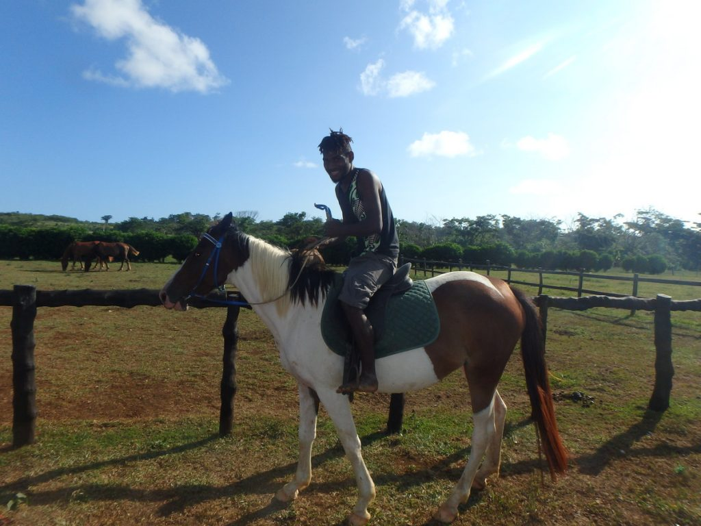 Sale riding his favorite horse at Tom's ranch (Bellevue Ranch in Port Vila)