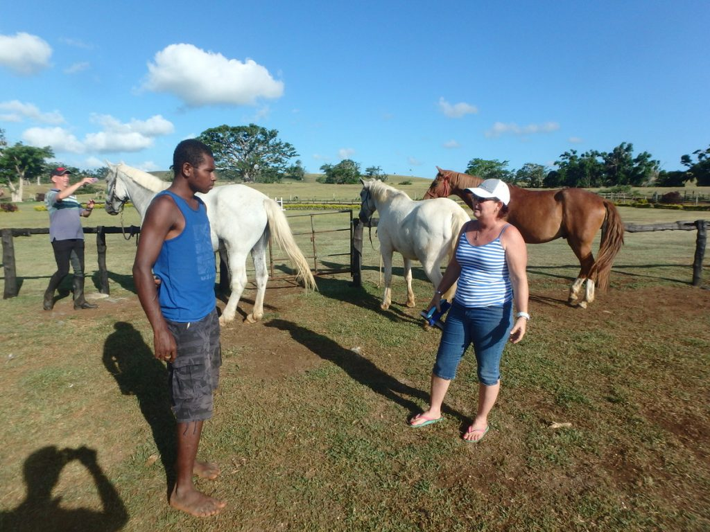 Charleston getting riding tips from a local horse trainer