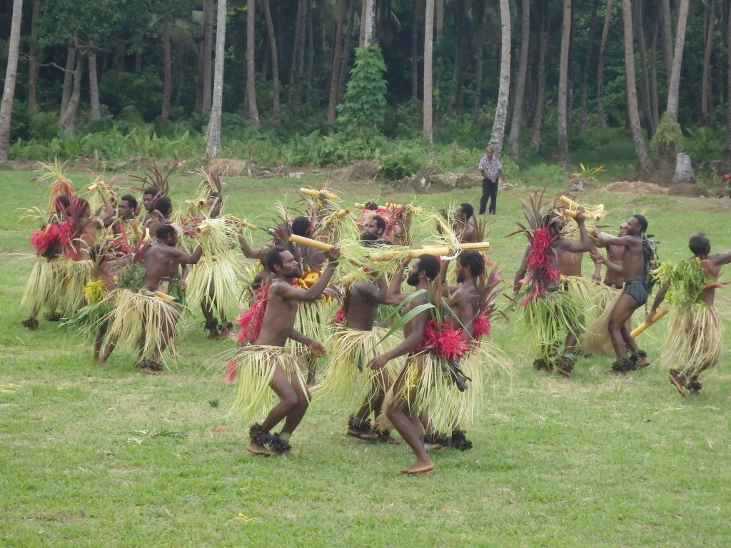 "Local men from East Maewo performing choreographed ""bamboo dance"" for the opening of the new Bakanao Primary School classroom"